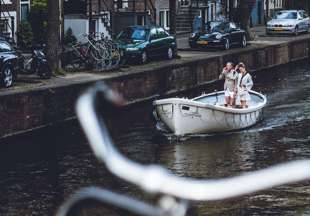 Couple boating, Amsterdam canals